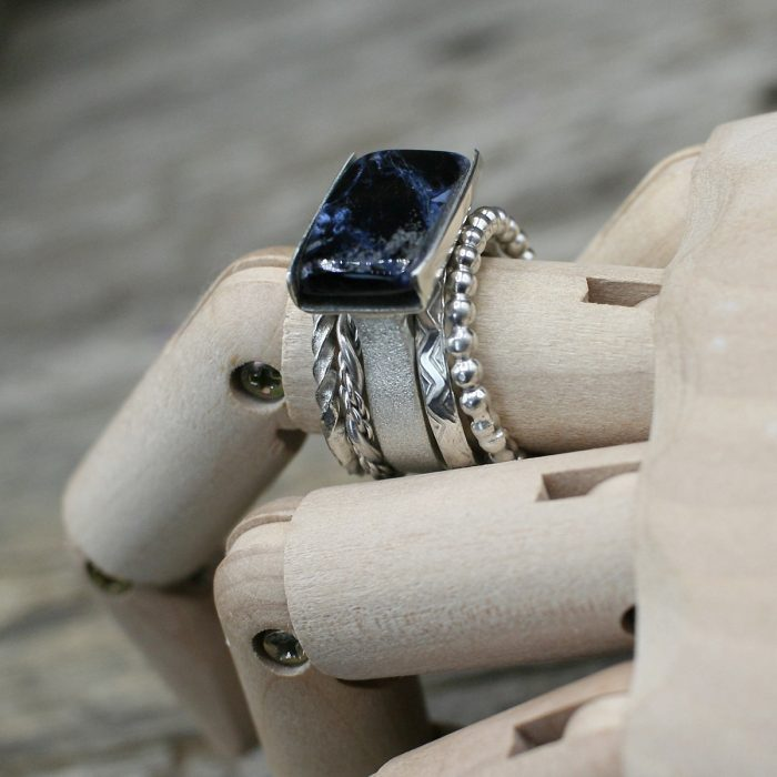 Blue Tempest Stone Ring layered with Stacker Rings