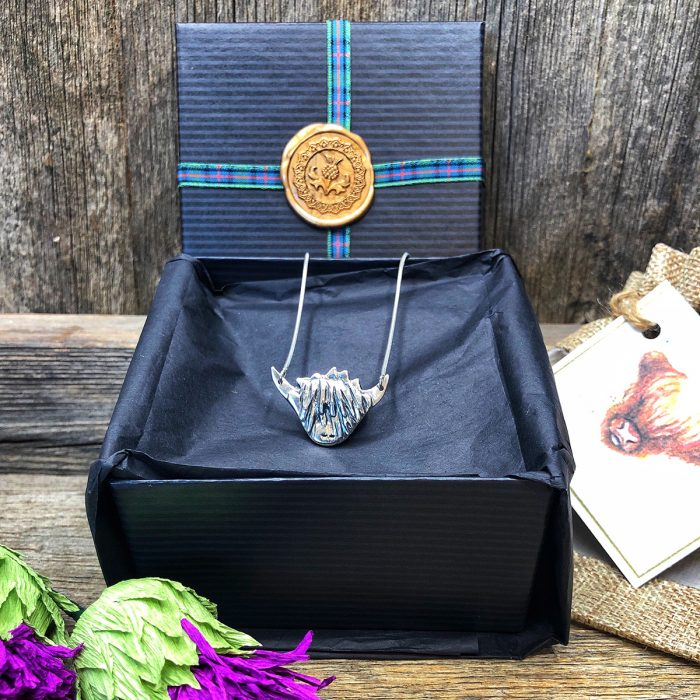 Mama Coo Highland Cow Necklace in packaging